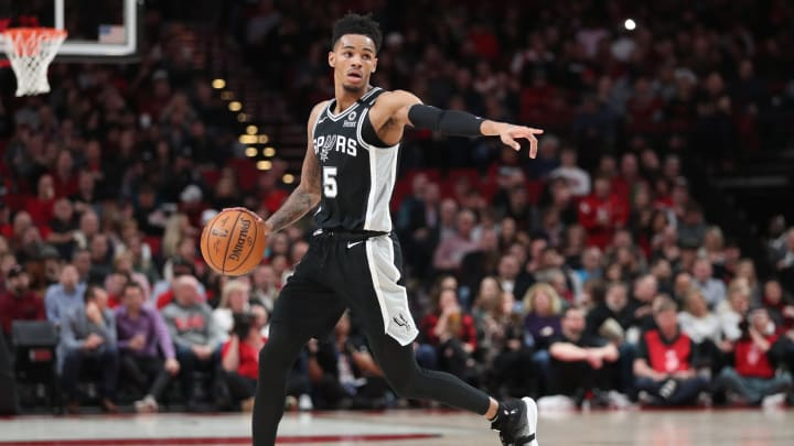 PORTLAND, OREGON – FEBRUARY 06: Dejounte Murray #5 of the San Antonio Spurs dribbles with the ball in the first quarter against the Portland Trail Blazers. (Photo by Abbie Parr/Getty Images)