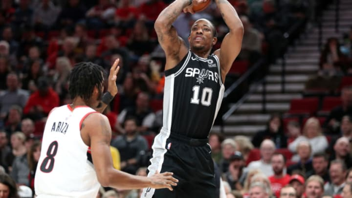 PORTLAND, OREGON - FEBRUARY 06: DeMar DeRozan #10 of the San Antonio Spurs takes a shot against Trevor Ariza #8 of the Portland Trail Blazers in the first quarter during their game at Moda Center on February 06, 2020 in Portland, Oregon. NOTE TO USER: User expressly acknowledges and agrees that, by downloading and or using this photograph, User is consenting to the terms and conditions of the Getty Images License Agreement. (Photo by Abbie Parr/Getty Images)