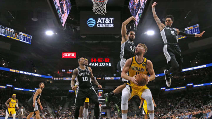 SAN ANTONIO, TX - MARCH 02: Domantas Sabonis #11 of the Indiana Pacers looks to shoot in front of Trey Lyles #41 of the San Antonio Spurs and Dejounte Murray during second half action at AT&T Center. (Photo by Ronald Cortes/Getty Images)