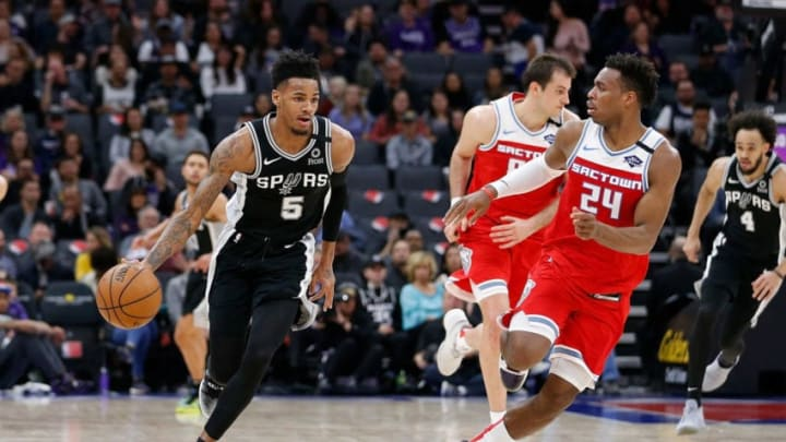 SACRAMENTO, CALIFORNIA - FEBRUARY 08: Dejounte Murray #5 of the San Antonio Spurs dribbles the ball up court in the first half against the Sacramento Kings at Golden 1 Center (Photo by Lachlan Cunningham/Getty Images)