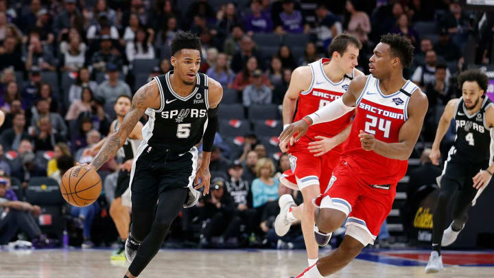 SACRAMENTO, CALIFORNIA – FEBRUARY 08: Dejounte Murray #5 of the San Antonio Spurs dribbles the ball up court in the first half against the Sacramento Kings at Golden 1 Center (Photo by Lachlan Cunningham/Getty Images)