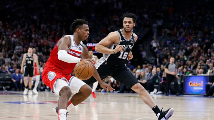 SACRAMENTO, CALIFORNIA - FEBRUARY 08: Buddy Hield #24 of the Sacramento Kings is defended by Quinndary Weatherspoon #15 of the San Antonio Spurs in the second half at Golden 1 Center on February 08, 2020 in Sacramento, California. NOTE TO USER: User expressly acknowledges and agrees that, by downloading and/or using this photograph, user is consenting to the terms and conditions of the Getty Images License Agreement. (Photo by Lachlan Cunningham/Getty Images)
