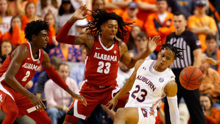 AUBURN, ALABAMA - FEBRUARY 12: Two NBA Draft prospects, Isaac Okoro #23 of the Auburn Tigers and Kira Lewis Jr. #2 of the Alabama Crimson Tide have the drive to be San Antonio Spurs players. (Photo by Kevin C. Cox/Getty Images)