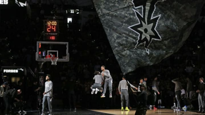 SAN ANTONIO, TX - MARCH 10: During player introduction Patty Mills #8 of the San Antonio Spurs jumps with Bryn Forbes #11 of the San Antonio Spurs before the start of the game against the Dallas Mavericks at AT&T Center on March 10, 2020 in San Antonio, Texas. NOTE TO USER: User expressly acknowledges and agrees that , by downloading and or using this photograph, User is consenting to the terms and conditions of the Getty Images License Agreement. (Photo by Ronald Cortes/Getty Images)