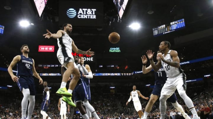 SAN ANTONIO, TX - MARCH 10: Trey Lyles #41 of the San Antonio Spurs passes off to DeMar DeRozan #10 during first half action at AT&T Center on March 10, 2020 in San Antonio, Texas. San Antonio Spurs defeated the Dallas Mavericks 119-109. NOTE TO USER: User expressly acknowledges and agrees that , by downloading and or using this photograph, User is consenting to the terms and conditions of the Getty Images License Agreement. (Photo by Ronald Cortes/Getty Images)