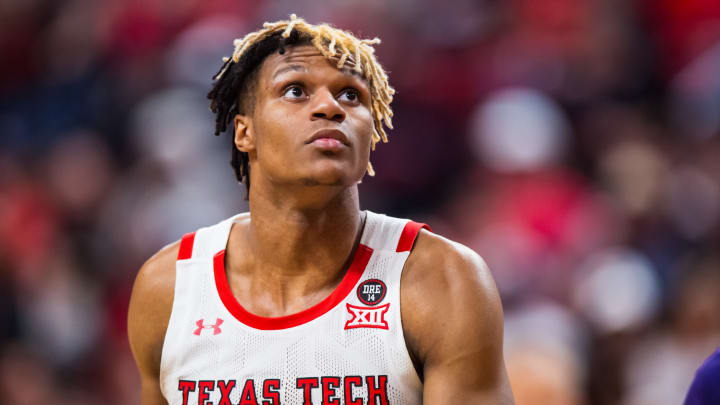 LUBBOCK, TEXAS – FEBRUARY 19: Guard Jahmi'us Ramsey #3 of the Texas Tech Red Raiders, who'd be a good fit for the San Antonio Spurs looks at the basket against the Kansas State Wildcats. (Photo by John E. Moore III/Getty Images)