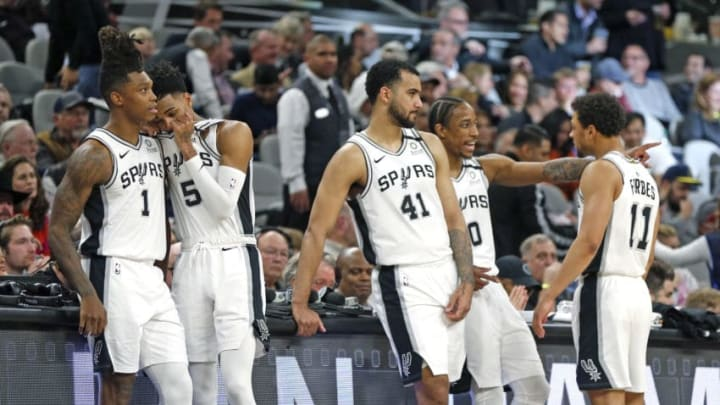 SAN ANTONIO, TX - FEBRUARY 26: Lonnie Walker #1 of the San Antonio Spurs,Dejounte Murray #5, Trey Lyles #41, DeMar DeRozan #10 , Bryn Forbes #11 wait while a play was being reviewed by officials during second half action (Photo by Ronald Cortes/Getty Images)