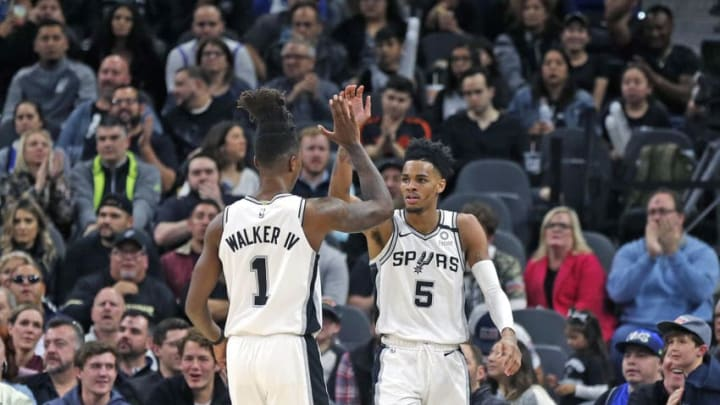 SAN ANTONIO, TX - FEBRUARY 26: Lonnie Walker #1 of the San Antonio Spurs high fives Dejounte Murray #5 after a basket against the Dallas Mavericks during second half action at AT&T Center. (Photo by Ronald Cortes/Getty Images)