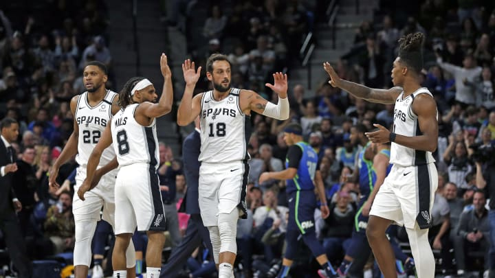 SAN ANTONIO, TX – FEBRUARY 26: Marco Belinelli #18 of the San Antonio Spurs receives high fives from Patty Mills #8, and Lonnie Walker #1 at AT&T Center in San Antonio, Texas. (Photo by Ronald Cortes/Getty Images)