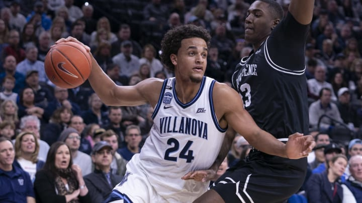 PHILADELPHIA, PA – FEBRUARY 29: Jeremiah Robinson-Earl #24 of the Villanova Wildcats dribbles the ball against Kalif Young #13 of the Providence Friars at the Wells Fargo Center on February 29, 2020 in Philadelphia, Pennsylvania. The Providence Friars defeated the Villanova Wildcats 58-54. (Photo by Mitchell Leff/Getty Images)