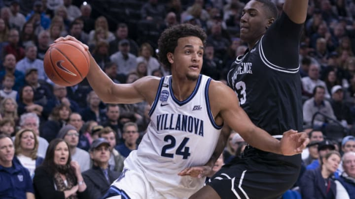 PHILADELPHIA, PA - FEBRUARY 29: Jeremiah Robinson-Earl #24 of the Villanova Wildcats dribbles the ball against Kalif Young #13 of the Providence Friars at the Wells Fargo Center on February 29, 2020 in Philadelphia, Pennsylvania. The Providence Friars defeated the Villanova Wildcats 58-54. (Photo by Mitchell Leff/Getty Images)