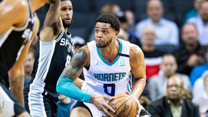 CHARLOTTE, NORTH CAROLINA - MARCH 03: Miles Bridges #0 of the Charlotte Hornets is guarded by Patty Mills #8 of the San Antonio Spurs during the first quarter of their game at Spectrum Center on March 03, 2020 in Charlotte, North Carolina. NOTE TO USER: User expressly acknowledges and agrees that, by downloading and/or using this photograph, user is consenting to the terms and conditions of the Getty Images License Agreement. (Photo by Jacob Kupferman/Getty Images)