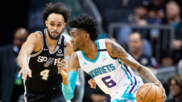 CHARLOTTE, NORTH CAROLINA – MARCH 03: Jalen McDaniels #6 of the Charlotte Hornets is guarded by Derrick White #4 of the San Antonio Spurs during the first quarter of their game at Spectrum Center (Photo by Jacob Kupferman/Getty Images)