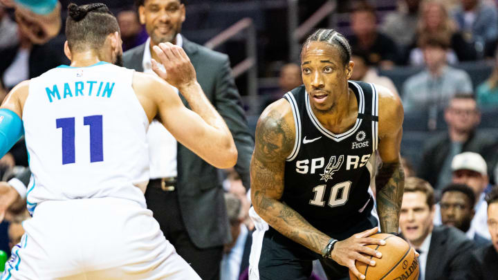 CHARLOTTE, NORTH CAROLINA – MARCH 03: DeMar DeRozan #10 of the San Antonio Spurs is guarded by Cody Martin #11 of the Charlotte Hornets during the second quarter of their game at Spectrum Center. (Photo by Jacob Kupferman/Getty Images)