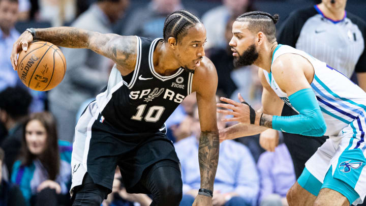 CHARLOTTE, NORTH CAROLINA – MARCH 03: DeMar DeRozan #10 of the San Antonio Spurs is defended by Cody Martin #11 of the Charlotte Hornets during the third quarter of their game at Spectrum Center (Photo by Jacob Kupferman/Getty Images)