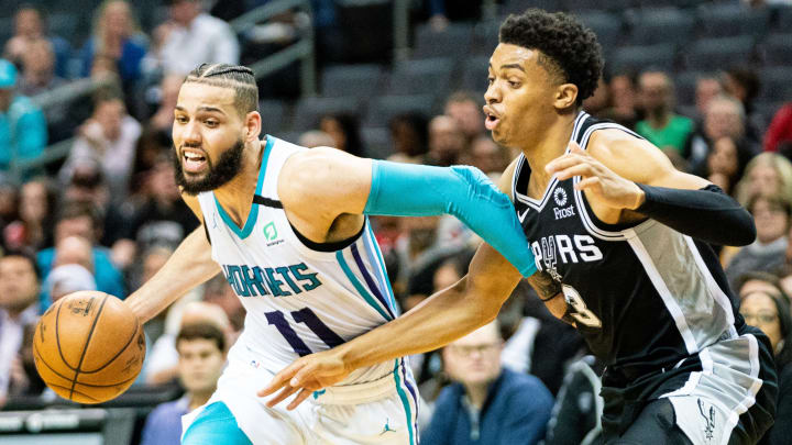 CHARLOTTE, NORTH CAROLINA – MARCH 03: Cody Martin #11 of the Charlotte Hornets is defended by Keldon Johnson #3 of the San Antonio Spurs during the fourth quarter (Photo by Jacob Kupferman/Getty Images)