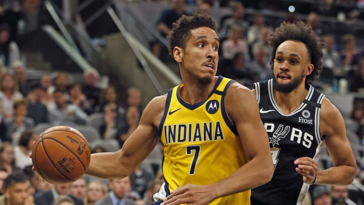 SAN ANTONIO, TX – MARCH 02: Malcolm Brogdon #7 of the Indiana Pacers drives past Derrick White #4 of the San Antonio Spurs during the second half action at AT&T Center. (Photo by Ronald Cortes/Getty Images)