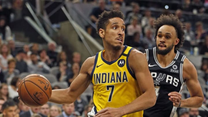 SAN ANTONIO, TX - MARCH 02: Malcolm Brogdon #7 of the Indiana Pacers drives past Derrick White #4 of the San Antonio Spurs during second half action at AT&T Center. (Photo by Ronald Cortes/Getty Images)