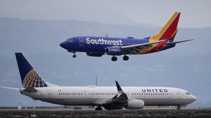 BURLINGAME, CALIFORNIA – MARCH 06: A Southwest Airlines plane lands next to a United Airlines plane at San Francisco International Airport on March 06, 2020 in Burlingame, California (Photo by Justin Sullivan/Getty Images)
