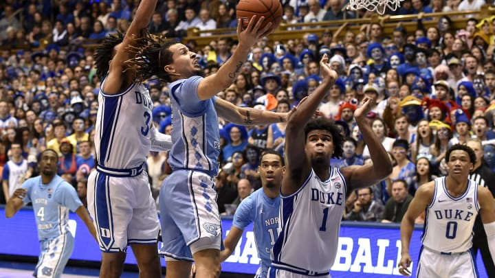 DURHAM, NORTH CAROLINA – MARCH 07: Cole Anthony #2 of the North Carolina Tar Heels drives between Tre Jones #3 and Vernon Carey Jr. #1 of the Duke Blue Devils (Photo by Grant Halverson/Getty Images)