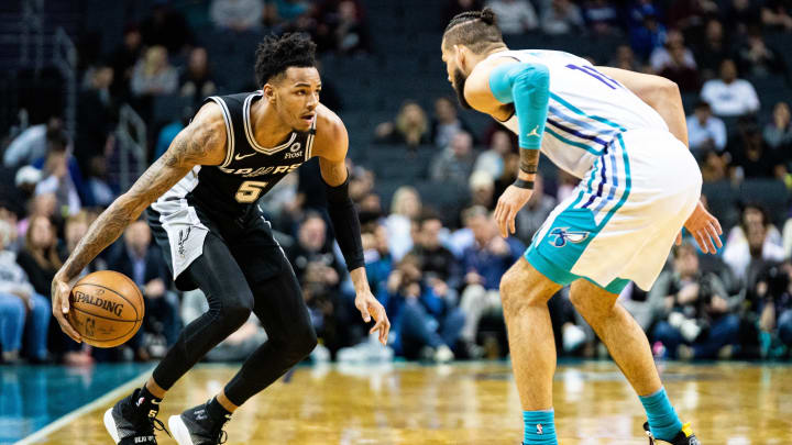 CHARLOTTE, NORTH CAROLINA – MARCH 03: Dejounte Murray #5 of the San Antonio Spurs and Cody Martin #11 of the Charlotte Hornets during their game at Spectrum Center (Photo by Jacob Kupferman/Getty Images)