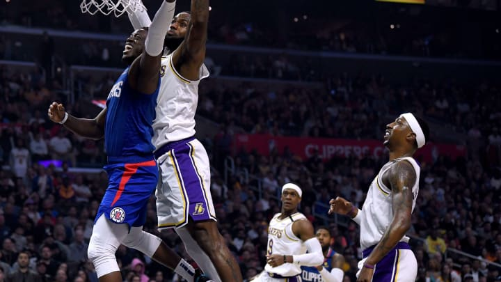 LOS ANGELES, CALIFORNIA – MARCH 08: Reggie Jackson #1 of the LA Clippers has his shot blocked by LeBron James. (Photo by Harry How/Getty Images)