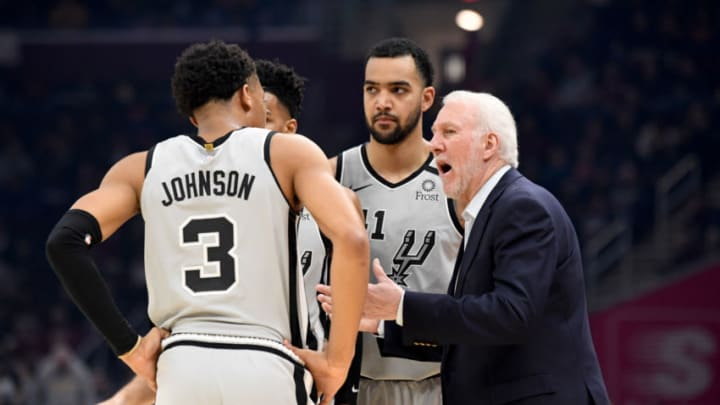 CLEVELAND, OHIO - MARCH 08: Head coach Gregg Popovich of the San Antonio Spurs talks with Dejounte Murray #5, Keldon Johnson #3 and Trey Lyles #41 during the first half at Rocket Mortgage Fieldhouse (Photo by Jason Miller/Getty Images)