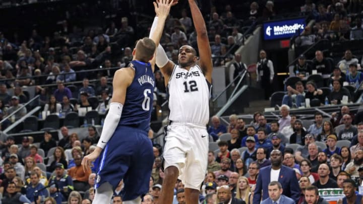 SAN ANTONIO, TX - FEBRUARY 26: LaMarcus Aldridge #12 of the San Antonio Spurs shoots over Kristaps Porzingis #6 of the Dallas Mavericks in front of a full crowd during second half action at AT&T Center on February 26, 2020 in San Antonio, Texas. San Antonio Spurs defeated the Dallas Mavericks 119-109. NOTE TO USER: User expressly acknowledges and agrees that , by downloading and or using this photograph, User is consenting to the terms and conditions of the Getty Images License Agreement. (Photo by Ronald Cortes/Getty Images)