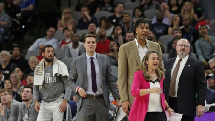 SAN ANTONIO, TX - FEBRUARY 26: Assistant coach of the San Antonio Spurs Becky Hammond and Tim Duncan react to a play during first half action at AT&T Center on February 26, 2020 in San Antonio, Texas. San Antonio Spurs defeated the Dallas Mavericks 119-109. NOTE TO USER: User expressly acknowledges and agrees that , by downloading and or using this photograph, User is consenting to the terms and conditions of the Getty Images License Agreement. (Photo by Ronald Cortes/Getty Images)