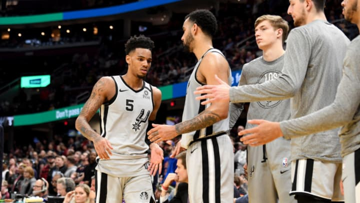 CLEVELAND, OHIO - MARCH 08: Dejounte Murray #5 of the San Antonio Spurs celebrates with teammates during overtime against the Cleveland Cavaliers at Rocket Mortgage Fieldhouse on March 08, 2020 in Cleveland, Ohio. (Photo by Jason Miller/Getty Images)