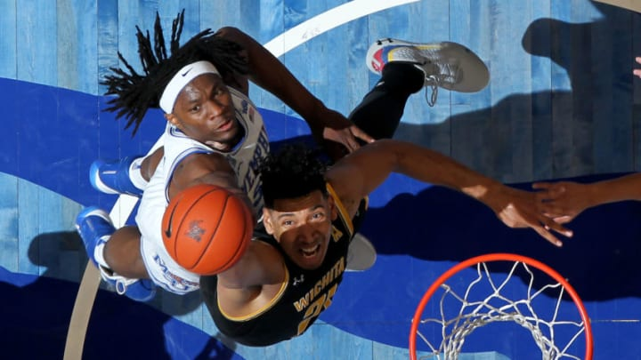 """MEMPHIS, TN - MARCH 05: NBA Draft prospect Precious Achiuwa #55, who the San Antonio Spurs may consider, jumps for a rebound against Jaime Echenique #21 of the Wichita State Shockers (Photo by Joe Murphy/Getty Images)""""n"""