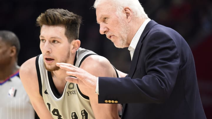 CLEVELAND, OHIO – MARCH 08: Drew Eubanks #14 listens to Head coach Gregg Popovich of the San Antonio Spurs against the Cleveland Cavaliers at Rocket Mortgage Fieldhouse (Photo by Jason Miller/Getty Images)