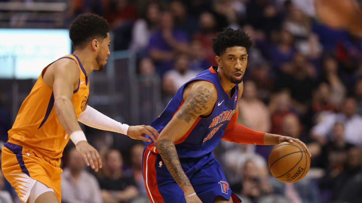 PHOENIX, ARIZONA – FEBRUARY 28: Christian Wood #35 of the Detroit Pistons handles the ball against Devin Booker #1 of the Phoenix Suns during the first half of the NBA game (Photo by Christian Petersen/Getty Images)
