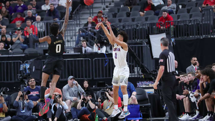 LAS VEGAS, NEVADA – MARCH 11: Josh Green #0 of the Arizona Wildcats shoots the ball over Jaden McDaniels #0 of the Washington Huskies during the first round of the Pac-12 Conference basketball tournament at T-Mobile Arena on March 11, 2020 in Las Vegas, Nevada. (Photo by Leon Bennett/Getty Images)