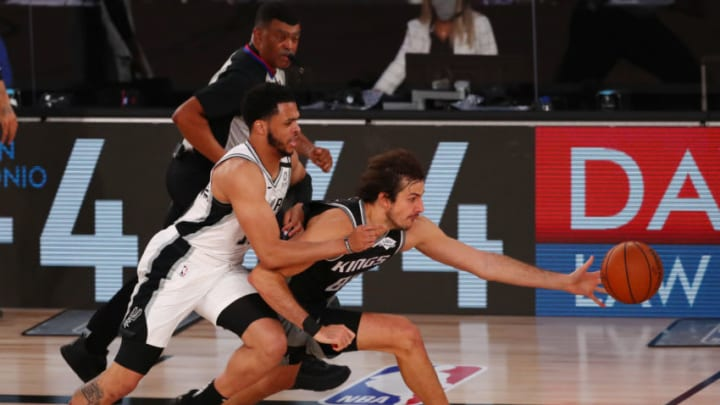 LAKE BUENA VISTA, FLORIDA - JULY 31: Quinndary Weatherspoon #15 of the San Antonio Spurs and Nemanja Bjelica #88 of the Sacramento Kings go after a loose ball in the second half of an NBA basketball game at the Visa Athletic Center in the ESPN Wide World Of Sports Complex on July 31, 2020 in Lake Buena Vista, Florida. NOTE TO USER: User expressly acknowledges and agrees that, by downloading and or using this photograph, User is consenting to the terms and conditions of the Getty Images License Agreement. (Photo by Kim Klement - Pool/Getty Images)