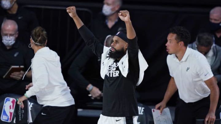 LAKE BUENA VISTA, FLORIDA - AUGUST 02: Patty Mills #8 of the San Antonio Spurs celebrates from the bench during action against the Memphis Grizzlies at Visa Athletic Center at ESPN Wide World Of Sports Complex on August 2, 2020 in Lake Buena Vista, Florida. NOTE TO USER: User expressly acknowledges and agrees that, by downloading and or using this photograph, User is consenting to the terms and conditions of the Getty Images License Agreement. (Photo by Ashley Landis-Pool/Getty Images)