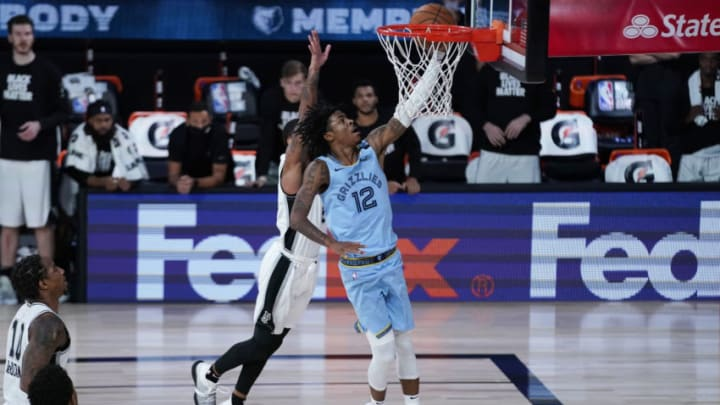 LAKE BUENA VISTA, FLORIDA - AUGUST 02: Ja Morant #12 of the Memphis Grizzlies shoots ahead of Dejounte Murray #5 of the during the San Antonio Spurs second half at Visa Athletic Center at ESPN Wide World Of Sports Complex on August 2, 2020 in Lake Buena Vista, Florida. NOTE TO USER: User expressly acknowledges and agrees that, by downloading and or using this photograph, User is consenting to the terms and conditions of the Getty Images License Agreement. (Photo by Ashley Landis-Pool/Getty Images)