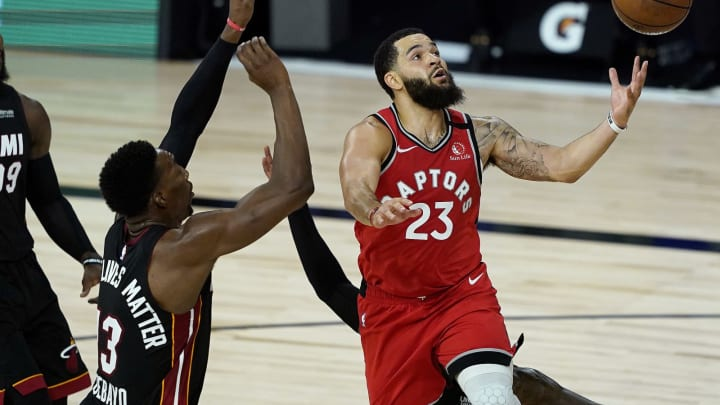 LAKE BUENA VISTA, FLORIDA – AUGUST 03: Fred VanVleet #23 of the Toronto Raptors shoots as Bam Adebayo #13 of the Miami Heat defends during a game at HP Field House. (Photo by Ashley Landis-Pool/Getty Images)