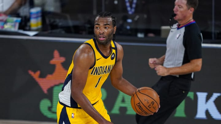 LAKE BUENA VISTA, FLORIDA – AUGUST 04: T.J. Warren #1 of the Indiana Pacers controls the ball against the Orlando Magic during the second half at Visa Athletic Center. (Photo by Ashley Landis-Pool/Getty Images)