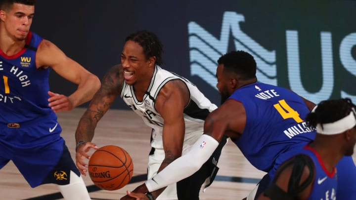 LAKE BUENA VISTA, FLORIDA – AUGUST 05: San Antonio Spurs forward DeMar DeRozan #10 is fouled by Denver Nuggets forward Paul Millsap #4 at ESPN Wide World Of Sports Complex. (Photo by Kim Klement-Pool/Getty Images)