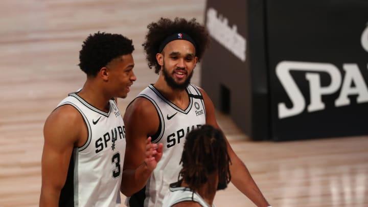San Antonio Spurs Keldon Johnson Derrick White Patty Mills (Photo by Kim Klement-Pool/Getty Images)