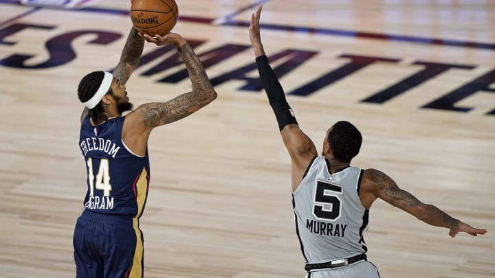 LAKE BUENA VISTA, FLORIDA – AUGUST 09: Brandon Ingram #14 of the New Orleans Pelicans takes a shot over Dejounte Murray #5 of the San Antonio Spurs at HP Field House. (Photo by Ashley Landis – Pool/Getty Images)