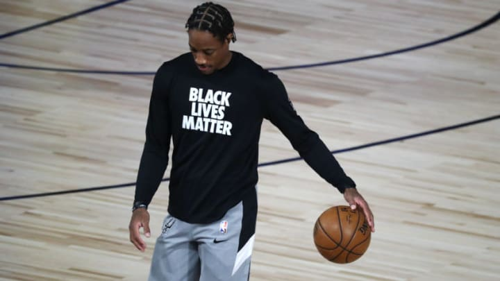 LAKE BUENA VISTA, FLORIDA - AUGUST 11: DeMar DeRozan #10 of the San Antonio Spurs warms up before a NBA basketball game against the Houston Rockets at The HP Field House. (Photo by Kim Klement-Pool/Getty Images)