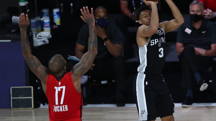LAKE BUENA VISTA, FLORIDA – AUGUST 11: Keldon Johnson #3 of the San Antonio Spurs shoots in front of P.J. Tucker #17 of the Houston Rockets during the second half of a NBA basketball game at The Field House at ESPN Wide World Of Sports Complex on August 11, 2020 in Lake Buena Vista, Florida. (Photo by Kim Klement-Pool/Getty Images)