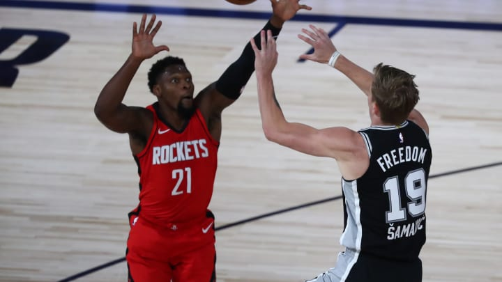 LAKE BUENA VISTA, FLORIDA – AUGUST 11: Luka Samanic #19 of the San Antonio Spurs passes while Michael Frazier #21 of the Houston Rockets defends at The Field House. (Photo by Kim Klement-Pool/Getty Images)