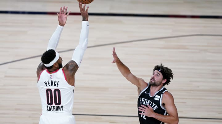LAKE BUENA VISTA, FLORIDA – AUGUST 13: Carmelo Anthony #00 of the Portland Trail Blazers shoots against Joe Harris #12 of the Brooklyn Nets during the 1st half at AdventHealth Arena. (Photo by Ashley Landis-Pool/Getty Images)