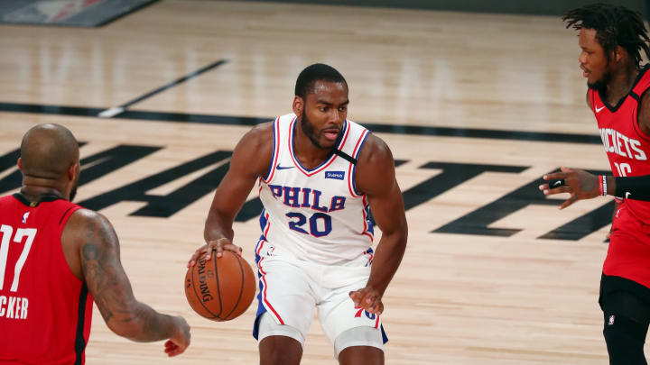 LAKE BUENA VISTA, FLORIDA – AUGUST 14: Alec Burks #20 of the Philadelphia 76ers controls the ball against Ben McLemore #16 and P.J. Tucker #17 of the Houston Rockets during the first half at AdventHealth Arena at ESPN Wide World Of Sports Complex on August 14, 2020. (Photo by Kim Klement – Pool/Getty Images)