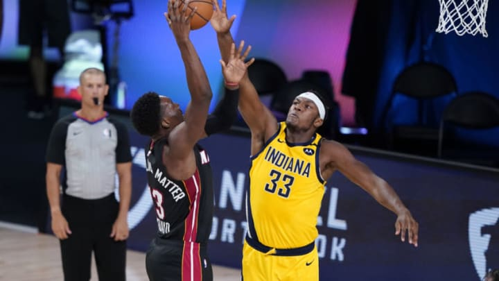 LAKE BUENA VISTA, FLORIDA - AUGUST 18: Bam Adebayo #13 of the Miami Heat shoots against Myles Turner #33 of the Indiana Pacers during the first half at AdventHealth Arena at ESPN Wide World Of Sports Complex on August 18, 2020 in Lake Buena Vista, Florida. NOTE TO USER: User expressly acknowledges and agrees that, by downloading and or using this photograph, User is consenting to the terms and conditions of the Getty Images License Agreement. (Photo by Ashley Landis-Pool/Getty Images)
