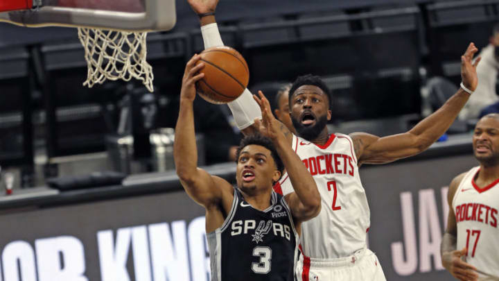 SAN ANTONIO, TX - JANUARY 14: Keldon Johnson #3 of the San Antonio Spurs #3 drives past David Nwaba #2 of the Houston Rockets at AT&T Center on January 14, 2021 in San Antonio, Texas. NOTE TO USER: User expressly acknowledges and agrees that , by downloading and or using this photograph, User is consenting to the terms and conditions of the Getty Images License Agreement. (Photo by Ronald Cortes/Getty Images)
