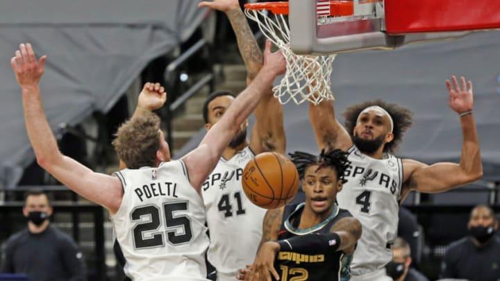 San Antonio Spurs Jakob Poeltl Trey Lyles Derrick White (Photo by Ronald Cortes/Getty Images)